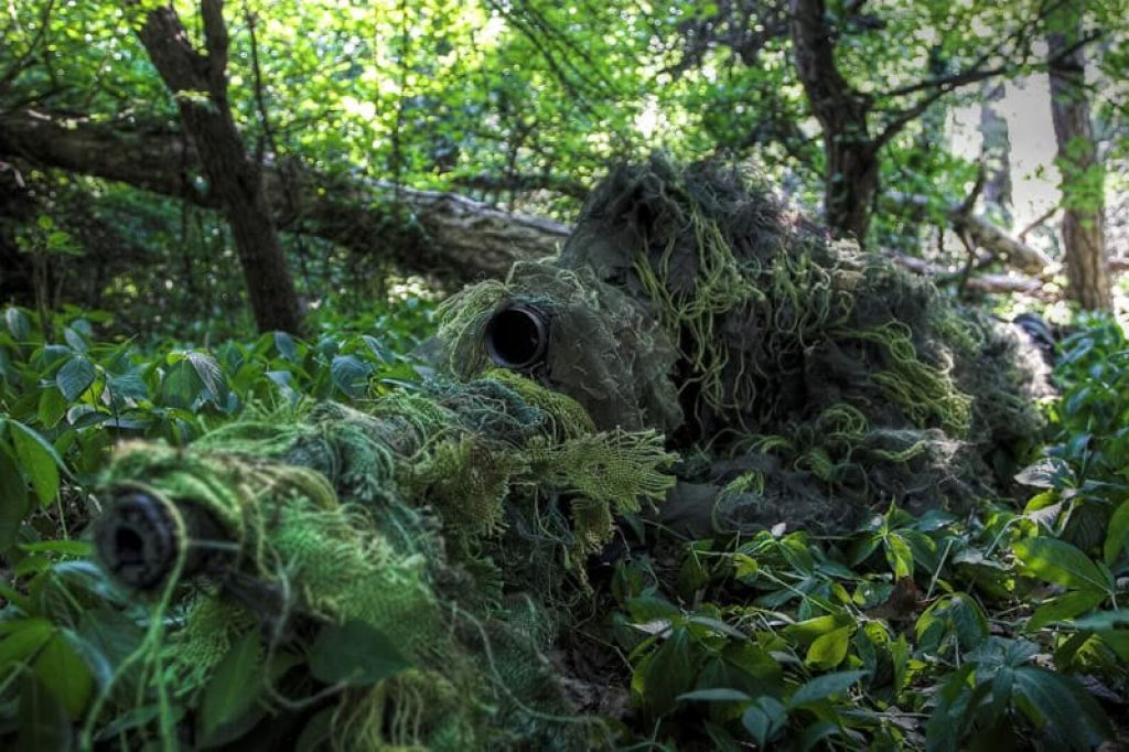 """airsoft ghillie suit man """"how to use a ghillie suit"""" header"""