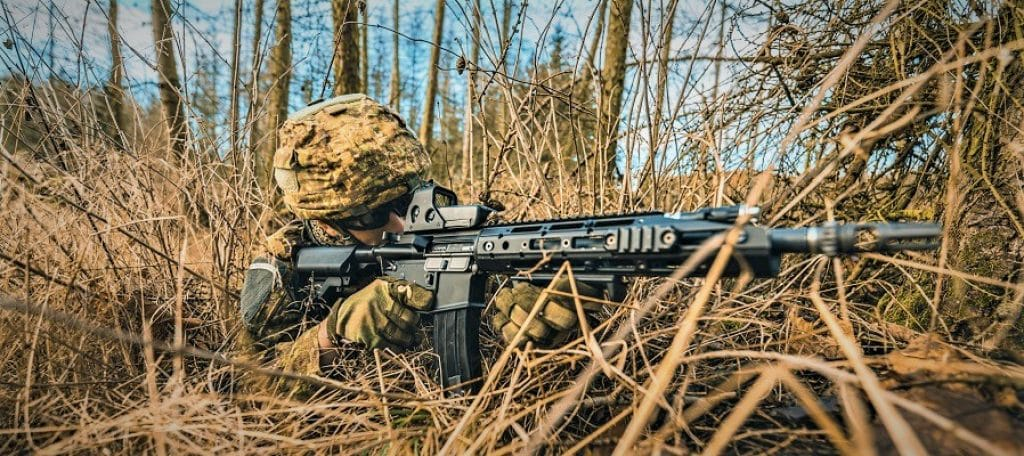 airsoft player going prone in military simulation operation