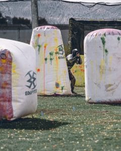 paintball players play with inflatable terrain