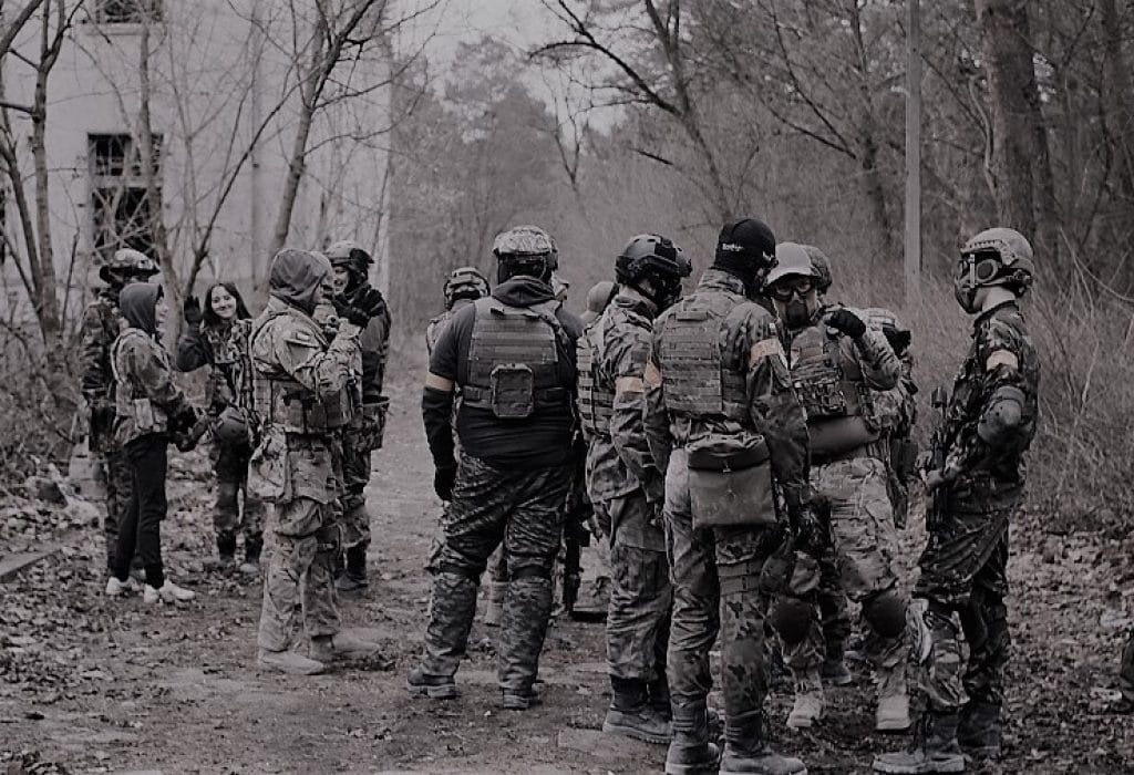 group of players gathering for an airsoft milsim event